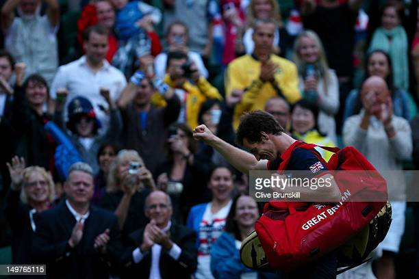 Andy Murray of Great Britain celebrates his 7-5, 7-5 win against Novak Djokovic of Serbia in the Semifinal of Men's Singles Tennis on Day 7 of the...