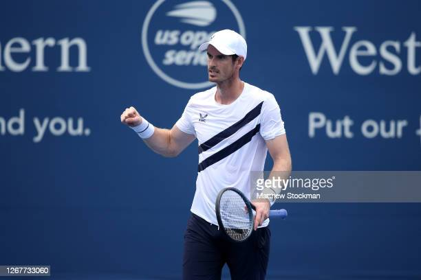 Andy Murray of Great Britain celebrates match point after defeating Frances Tiafoe of the United States during their Men's Singles First Round match...