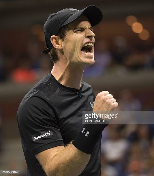 Andy Murray of Great Britain celebrates match point against Grigor Dimitrov of Bulgaria during their 2016 US Open men's singles match at the USTA...