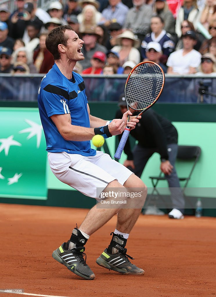 Andy Murray of Great Britain celebrates match point against Sam Querrey of the United States during day three of the Davis Cup World Group first round between the U.S. and Great Britain at PETCO Park on February 2, 2014 in San Diego, California.