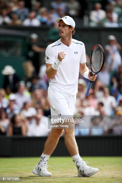 Andy Murray of Great Britain celebrates match point and victory during the Gentlemen's Singles fourth round match against Benoit Paire of France on...
