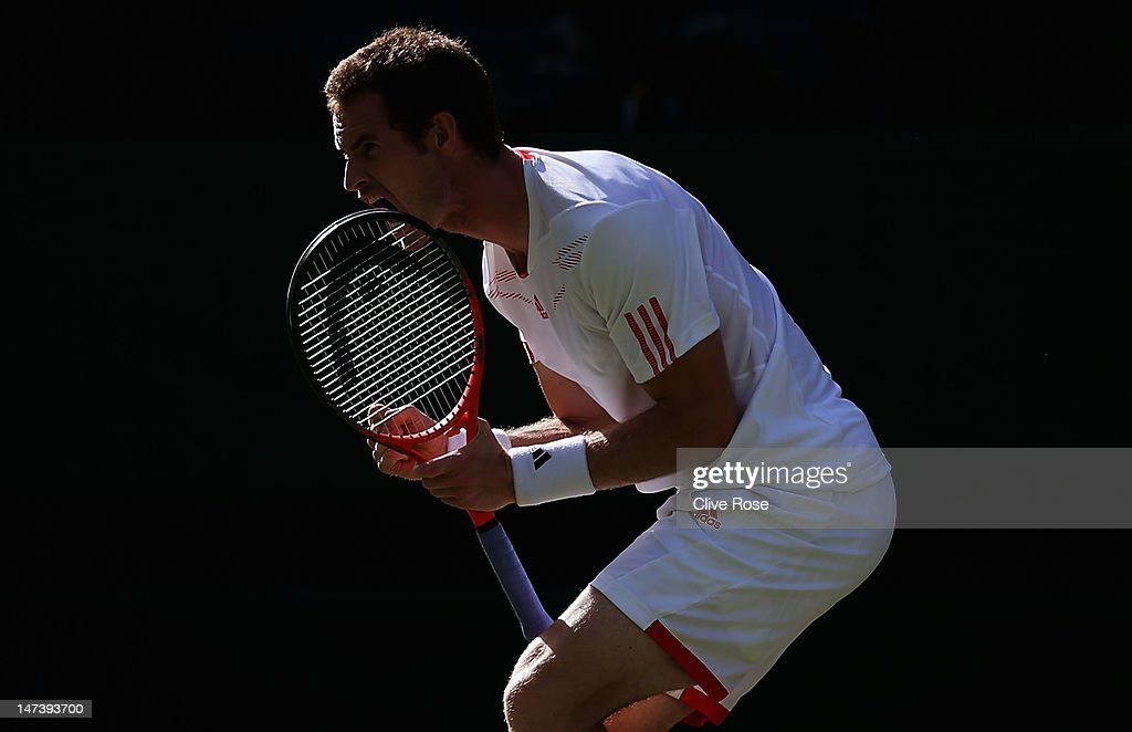 Andy Murray of Great Britain celebrates match point during his Gentlemen's Singles second round match against Ivo Karlovic of Croatia on day four of the Wimbledon Lawn Tennis Championships at the All England Lawn Tennis and Croquet Club on June 28, 2012 in London, England.