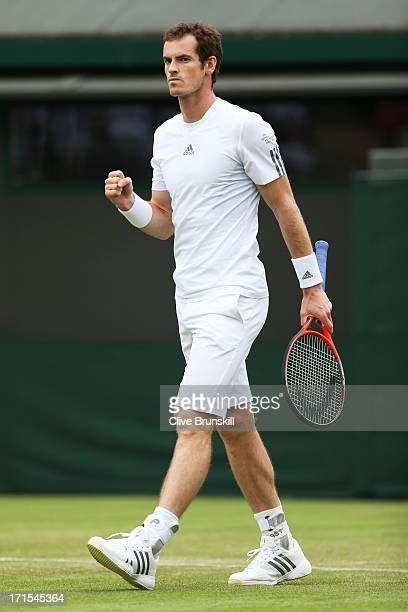 Andy Murray of Great Britain celebrates match point during his Gentlemen's Singles second round match against Lu YenHsun of Taipei on day three of...