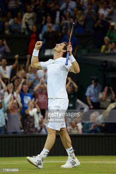 Andy Murray of Great Britain celebrates match point during the Gentlemen's Singles semi-final match against Jerzy Janowicz of Poland on day eleven of...