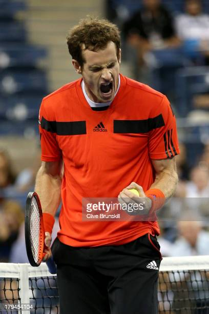 Andy Murray of Great Britain celebrates match point to win his men's singles fourth round match against Denis Istomin of Uzbekistan on Day Nine of...