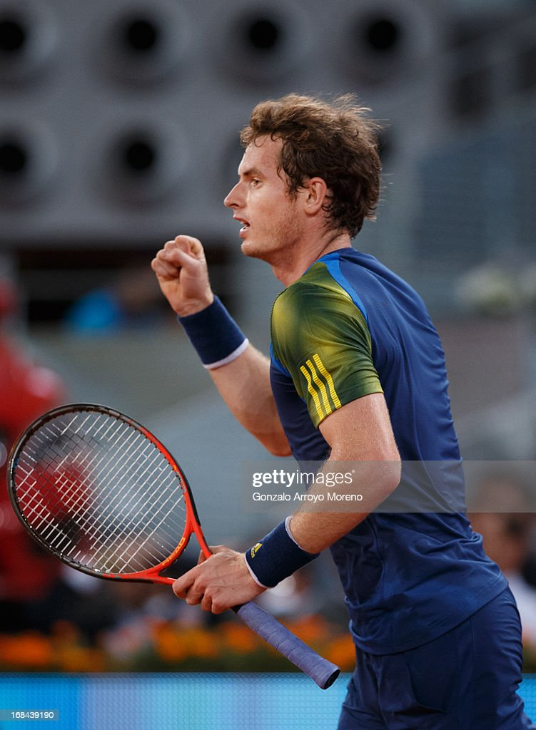 Andy Murray of Great Britain celebrates matchpoint over Gilles Simon of France on day six of the Mutua Madrid Open tennis tournament at the Caja Magica on May 9, 2013 in Madrid, Spain.