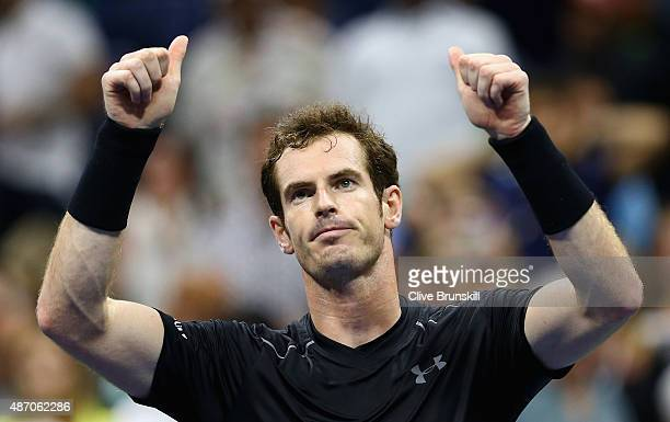 Andy Murray of Great Britain celebrates to the crowd after his straight sets victory against Thomaz Bellucci of Brazil during their mens singles...