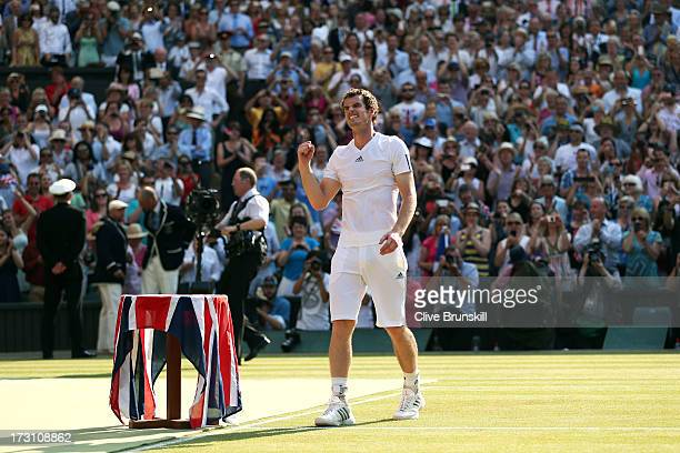 Andy Murray of Great Britain celebrates victory after the Gentlemen's Singles Final match against Novak Djokovic of Serbia on day thirteen of the...