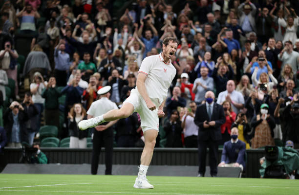 Andy Murray of Great Britain celebrates victory after winning his Men's Singles First Round match against Nikoloz Basilashvili of Georgia during Day...