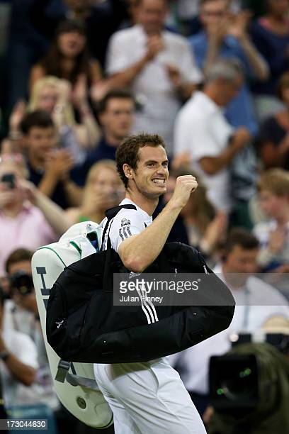 Andy Murray of Great Britain celebrates victory as he leaves Centre Court following his victory in the Gentlemen's Singles semi-final match against...