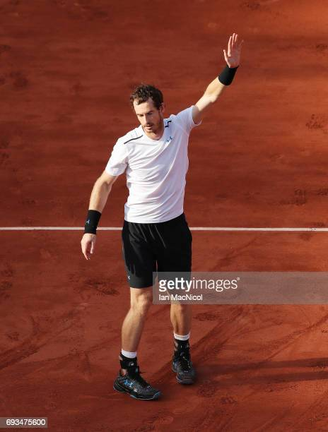 Andy Murray of Great Britain celebrates victory during his match with Kei Nishikori of Japan, on day eleven at Roland Garros on June 7, 2017 in...