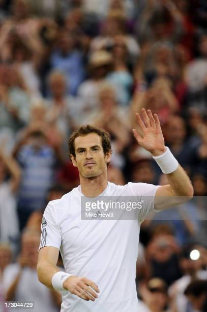 Andy Murray of Great Britain celebrates victory during the Gentlemen's Singles semi-final match against Jerzy Janowicz of Poland on day eleven of the...