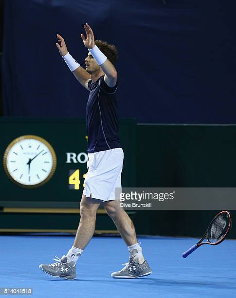 BIRMINGHAM ENGLAND MARCH Andy Murray of Great Britain celebrates victory following the singles match against Kei Nishikori of Japan on day three of...