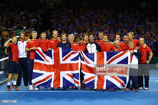 Andy Murray of Great Britain celebrates victory in his match against Bernard Tomic of Australia with his team-mates during Day Three of the Davis...
