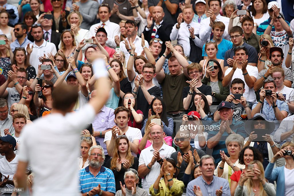 Andy Murray of Great Britain celebrates victory with supporters during the Men's Singles first round match against Liam Broady of Great Britain on day two of the Wimbledon Lawn Tennis Championships at the All England Lawn Tennis and Croquet Club on June 28, 2016 in London, England.