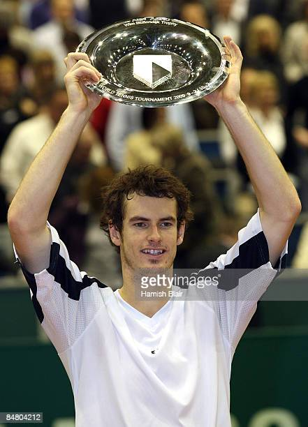 Andy Murray of Great Britain celebrates victory with the trophy after the singles final match against Rafael Nadal of Spain during day seven of the...