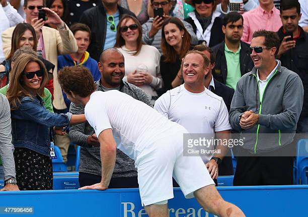Andy Murray of Great Britain celebrates victory with wife Kim Murray as coach Jonas Bjorkman looks on after his men's singles final match against...