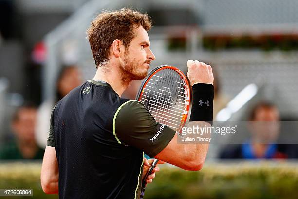Andy Murray of Great Britain celebrates winning a game against Milos Raonic of Canada in the quarter final during day seven of the Mutua Madrid Open...