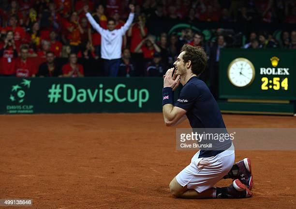 Andy Murray of Great Britain celebrates winning his singles match against David Goffin of Belgium and clinching the Davis Cup on day three of the...