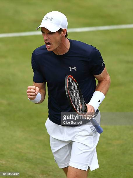 Andy Murray of Great Britain celebrates winning match point against JoWilfried Tsonga of France during Day One of the World Group Quarter Final Davis...