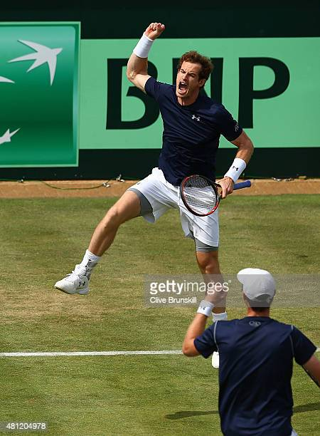 Andy Murray of Great Britain celebrates winning second set tie break with Jamie Murray of Great Britian against Nicolas Mahut and JoWilfried Tsonga...