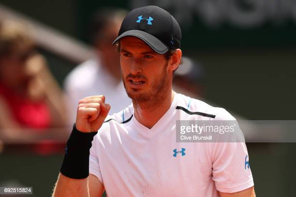 Andy Murray of Great Britain celebrates winning the second set during the men's singles fourth round match against Karen Khachanov of Russia on day...