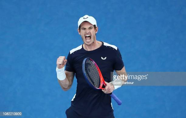Andy Murray of Great Britain celebrates winning the third set in his first round match against Roberto Bautista Agut of Spain during day one of the...