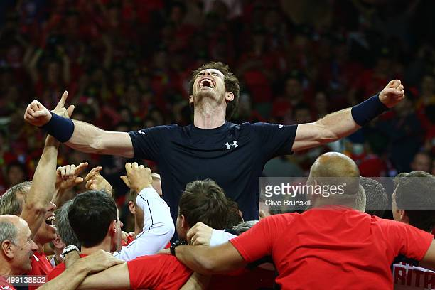 Andy Murray of Great Britain celebrates with his team after winning his singles match against David Goffin of Belgium and clinching the Davis Cup on...