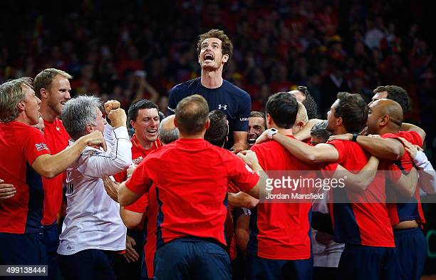 Andy Murray of Great Britain celebrates with his team-mates after winning his match to win the Davis Cup for Great Britain during day three of the...