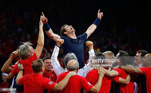Andy Murray of Great Britain celebrates with his teammates after winning his match to win the Davis Cup for Great Britain during day three of the...