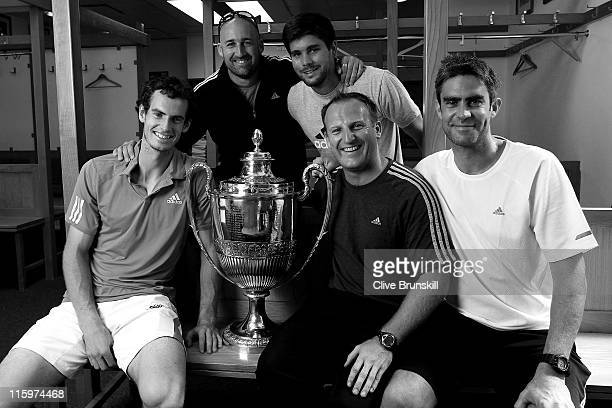 Andy Murray of Great Britain celebrates with his trophy in the dressing room with his coaching staff Jez Green Daniel Vallverdu Matt Little and...
