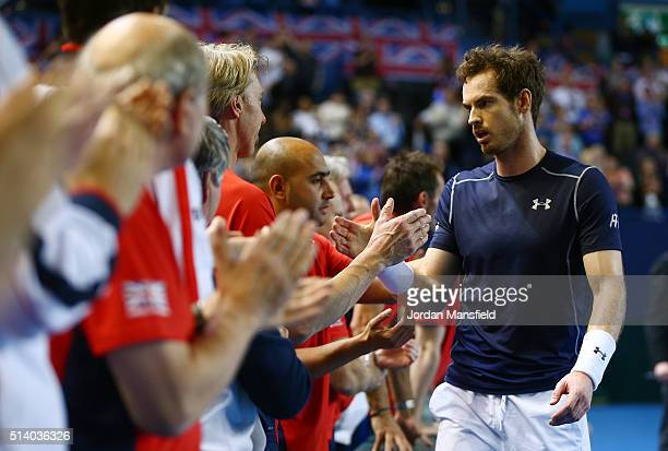 Andy Murray of Great Britain celebrates with teammates following his victory during the singles match against Kei Nishikori of Japan on day three of...