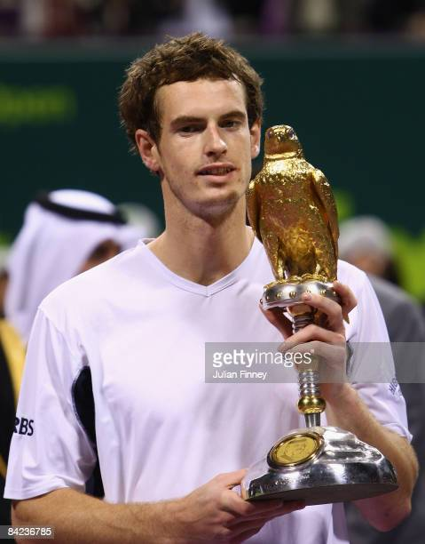 Andy Murray of Great Britain celebrates with the trophy after defeating Andy Roddick of United States in the final during the Exxon Mobil Qatar Open...