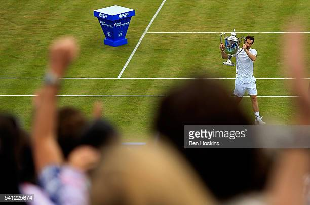 Andy Murray of Great Britain celebrates with the trophy after defeating Milos Raonic of Canada in the final of The Aegon Championships at The Queens...