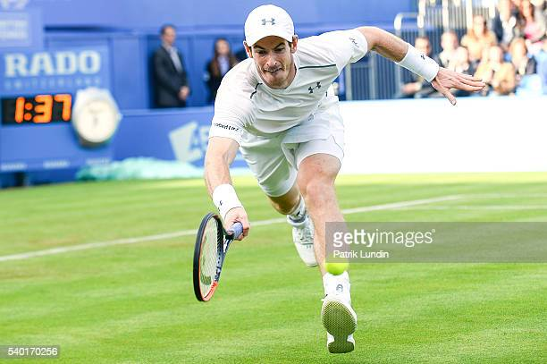 Andy Murray of Great Britain chases after a ball during the match against Nicolas Mahut of France on day 2 at Queens Club on June 14 2016 in London...