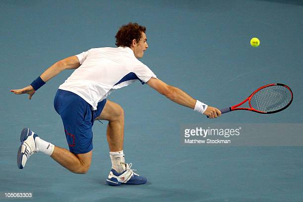 Andy Murray of Great Britain chases after a ball hit by Ivan Ljubicic of Croatia during day eight of the 2010 China Open at the National Tennis...