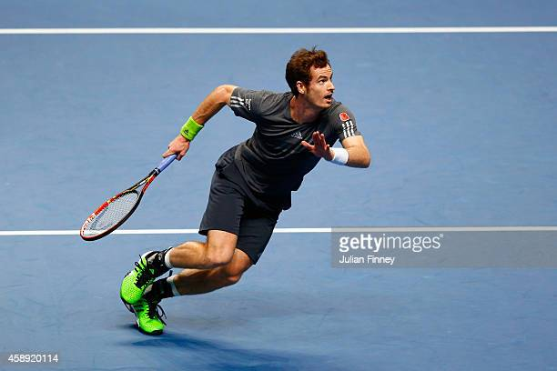 Andy Murray of Great Britain chases the ball in the round robin singles match against Roger Federer of Switzerland on day five of the Barclays ATP...
