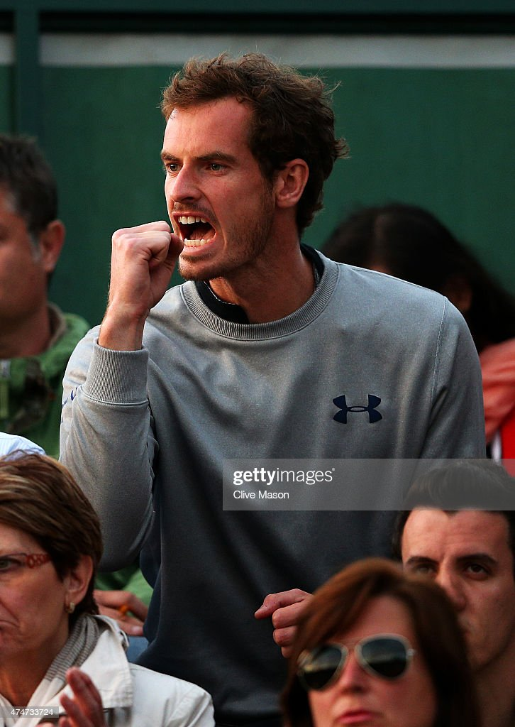 Andy Murray of Great Britain cheers on Kyle Edmund of Great Britain during his men's singles match against Stephane Robert of France on day two of the 2015 French Open at Roland Garros on May 25, 2015 in Paris, France.