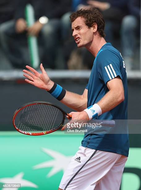 Andy Murray of Great Britain complains about the court against Andreas Seppi of Italy during day two of the Davis Cup World Group Quarter Final match...