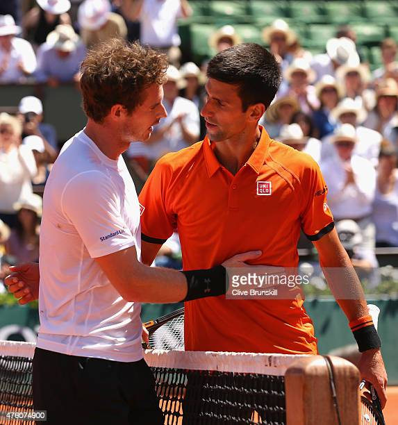 Andy Murray of Great Britain congratulates Novak Djokovic of Serbia after defeat in their Men's Semi Final match on day fourteen of the 2015 French...
