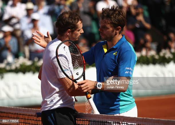 Andy Murray of Great Britain congratulates Stan Wawrinka of Switzerland on vicory in the mens singles semi-final match on day thirteen of the 2017...