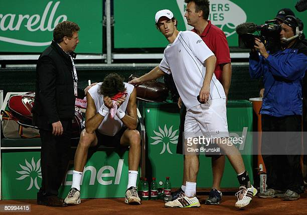Andy Murray of Great Britain consoles Juan Martin Del Potro of Argentina after he broke down with a back injury in the second game of the third set...