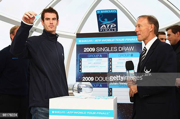 Andy Murray of Great Britain draws a name from the pot at the Barclays ATP World Tour Finals Player Draw on the London Eye on November 18 2009 in...
