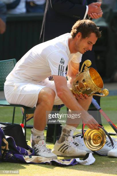 Andy Murray of Great Britain drops the lid of the Gentlemen's Singles Trophy following his victory in the Gentlemen's Singles Final match against...