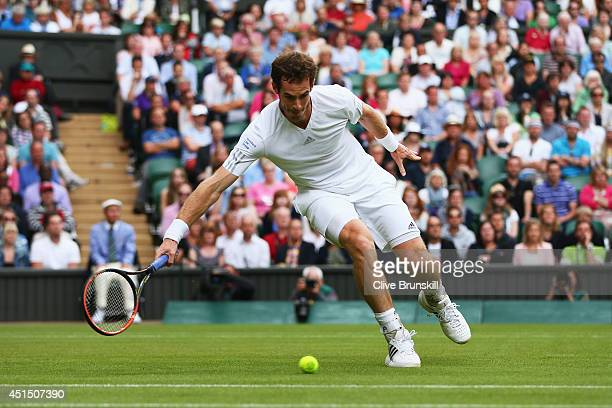 Andy Murray of Great Britain during his Gentlemen's Singles fourth round match against Kevin Anderson of South Africa on day seven of the Wimbledon...