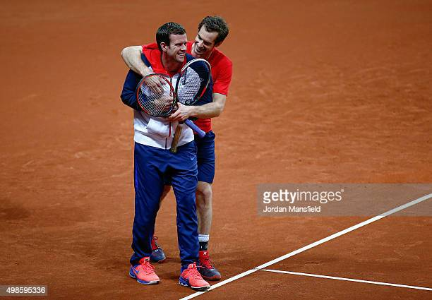 Andy Murray of Great Britain embraces Captain Leon Smith during a practice session ahead of the start of The Davis Cup at Flanders Expo on November...