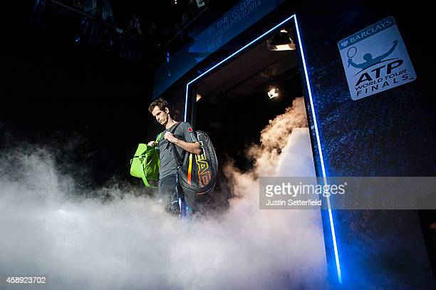 Andy Murray of Great Britain enters the court ahead of his round robin singles match against Roger Federer of Switzerland on day five of the Barclays...
