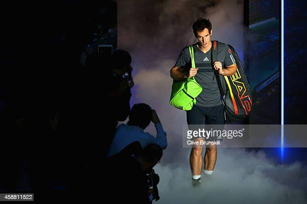Andy Murray of Great Britain enters the court in the round robin singles match against Milos Raonic of Canada on day three of the Barclays ATP World...