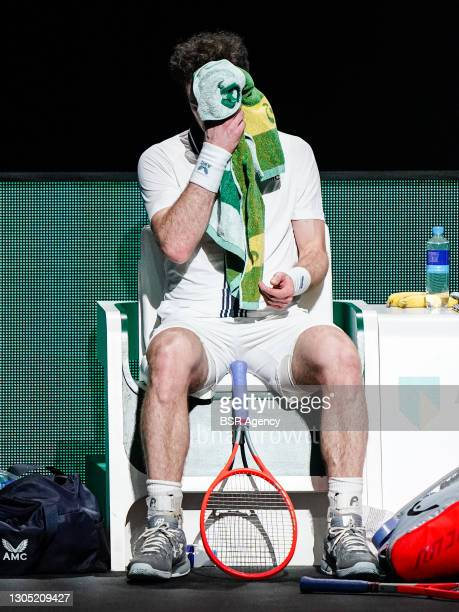 Andy Murray of Great Britain exhausted during his match against Andrey Rublev of Russia at the 48th ABN Amro Tennis World Tournament at Rotterdam...
