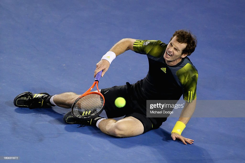 Andy Murray of Great Britain falls to the ground in his semifinal match against Roger Federer of Switzerland during day twelve of the 2013 Australian Open at Melbourne Park on January 25, 2013 in Melbourne, Australia.